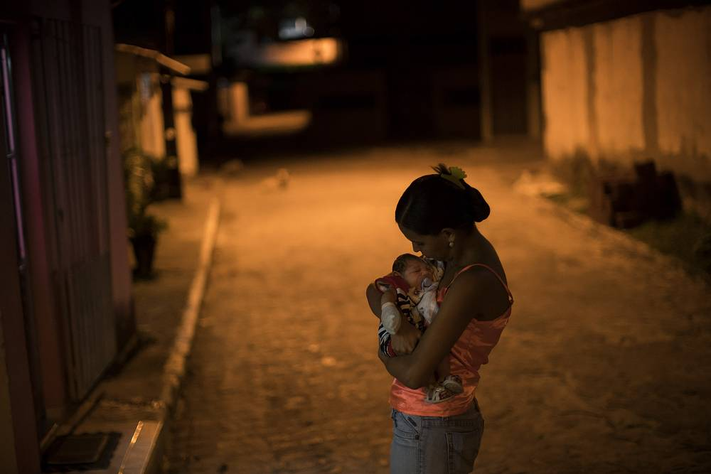 Pregnant women are warned to avoid travel to Latin American countries where the mosquito-borne virus is multiplying. Photo: Woman with a baby born with microcephaly in Recife, Brazil