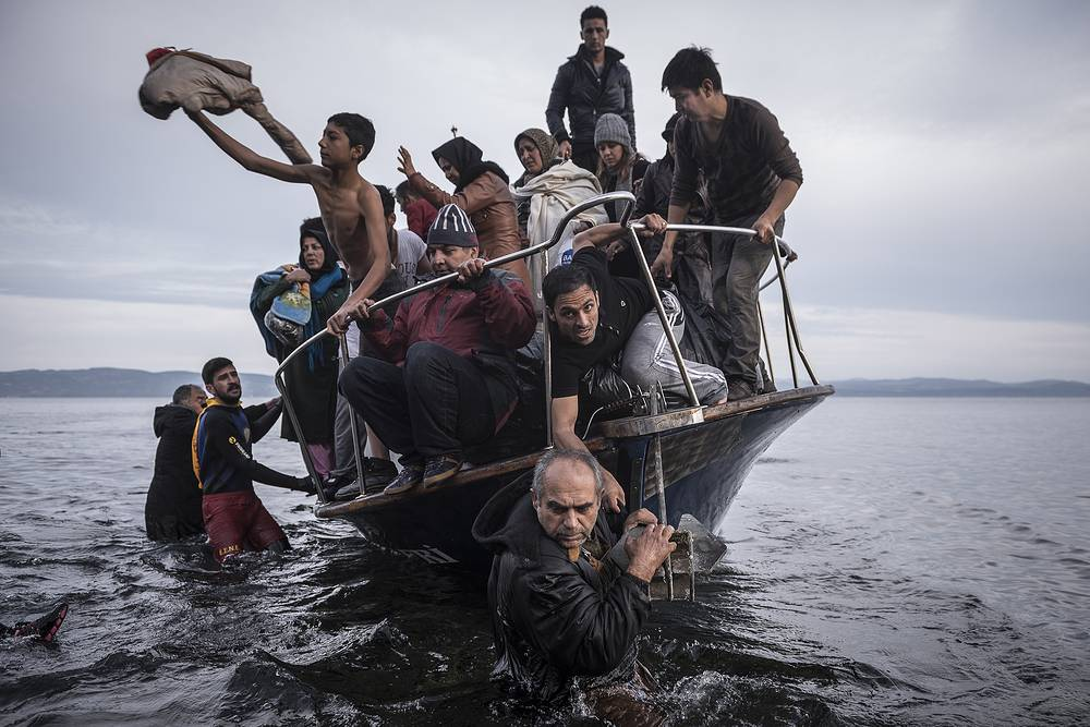 Russian photographer Sergey Ponomarev for The New York Times, First Prize Stories in the General News Category. The picture shows migrants and refugees arrived by boat in November 2015 near the village of Skala on the Greek island of Lesbos