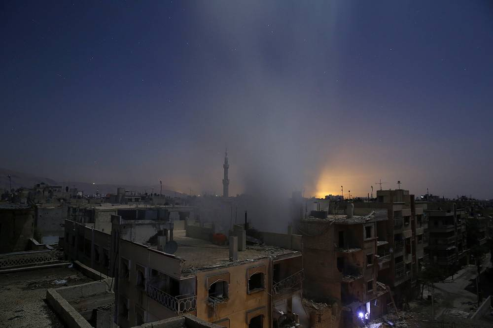 Sameer Al-Doumy, First Prize Stories in the Spot News Category. The picture shows smoke billowing from a building early on October 30, 2015, following reported shelling by Syrian government forces in the rebel-controlled area of Douma, east of Damascus