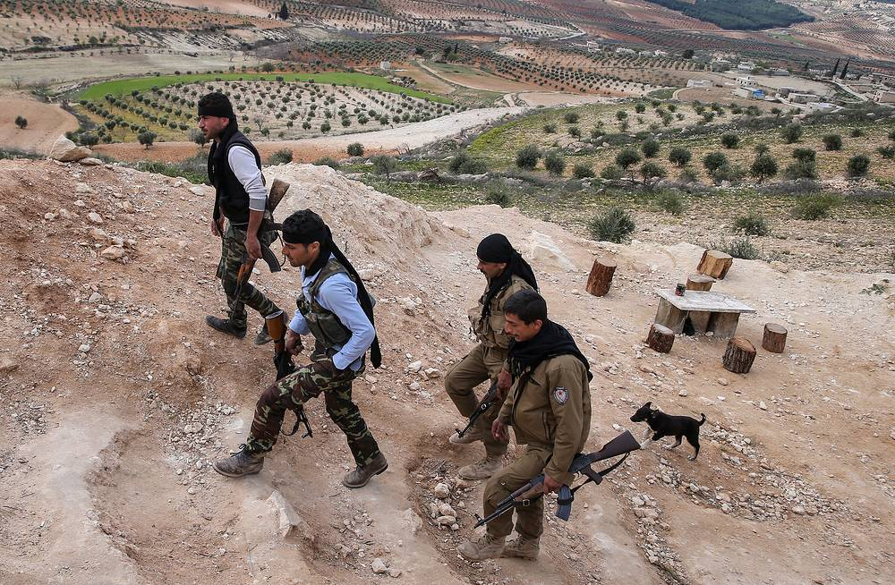 Armed Kurdish fighters near the Syrian-Turkish border