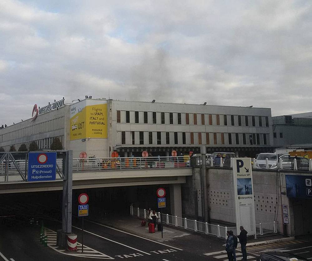Smoke seen at Brussels airport after twin blasts in Zaventem near Brussels, Belgium
