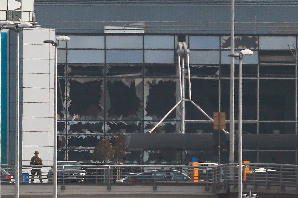 Destroyed windows at the terminal building after explosions at Brussels Airport