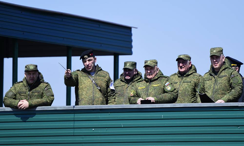 Pacific Fleet Commander, Admiral Sergei Avakyants (3rd R) watching a military drill