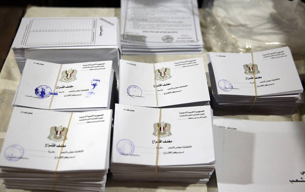 Election materials on a table ahead of Syrian parliamentary elections, in Damascus, Syria