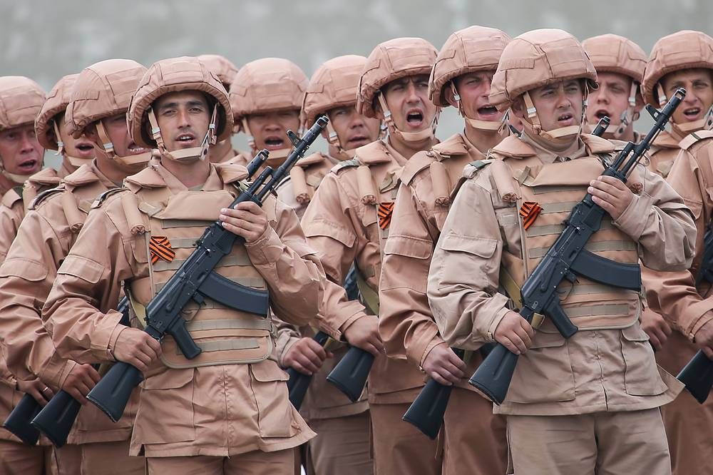 Russian soldiers marching in formation during a rehearsal for a 9 May parade at Hmeimim airbase in Syria