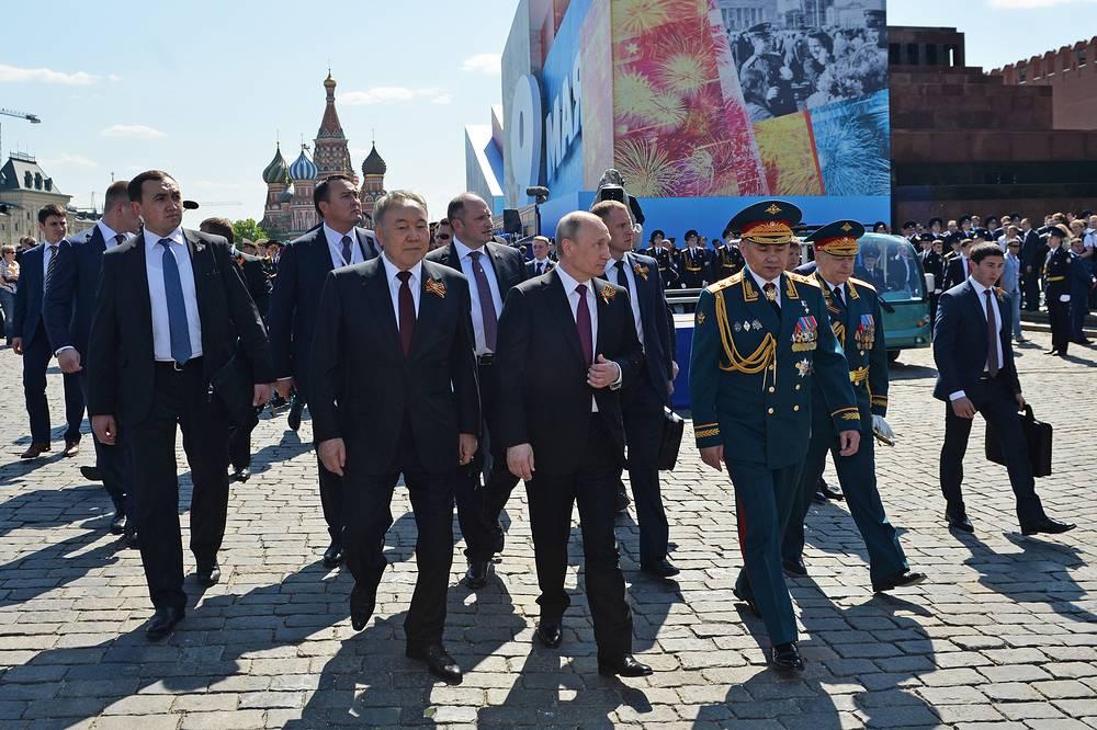 Kazakhstan's President Nursultan Nazarbayev, Russia's President Vladimir Putin, and Russia's Defense Minister Sergei Shoigu