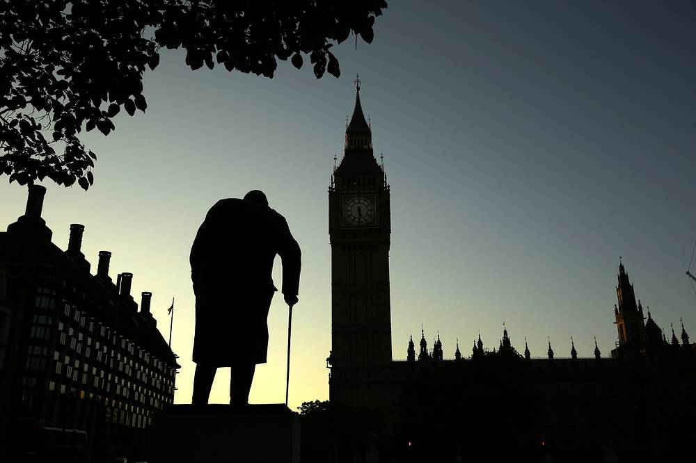 On June 23, Britain voted in a national referendum on whether to stay inside the EU. Photo: A statue of Winston Churchill is silhouetted against the Houses of Parliament and the early morning sky in London,