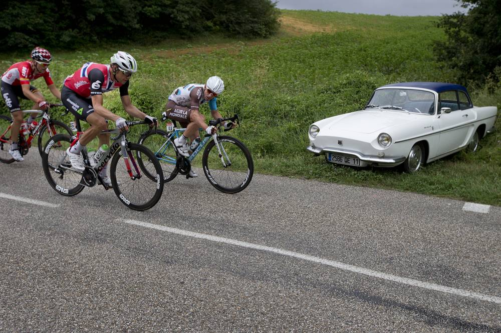 France's Samuel Dumoulin, Norway's Edvald Boasson Hagen and France's Tony Gallopin passing a 1962 Renault Caravelle classic car