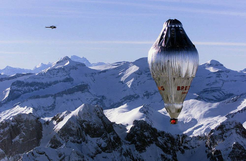 In 1999, Bertrand Piccard of Switzerland and Brian Jones of the UK made first non-stop balloon circumnavigation in Breitling Orbiter. They covered a distance of 40,000 kilometers starting from Switzerland and finishing in Egypt in 19 days, 21 hours and 55 minutes. Photo: Breitling Orbiter 3 balloon flying over the Swiss Alps
