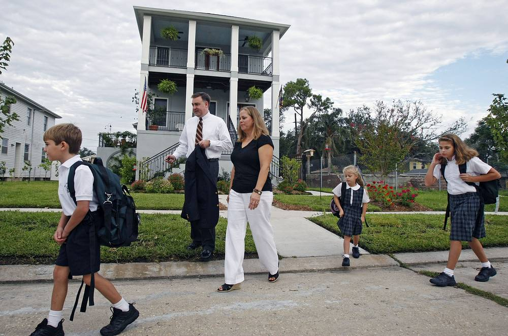 Children on their way to school in front of ther house in New Orleans, USA