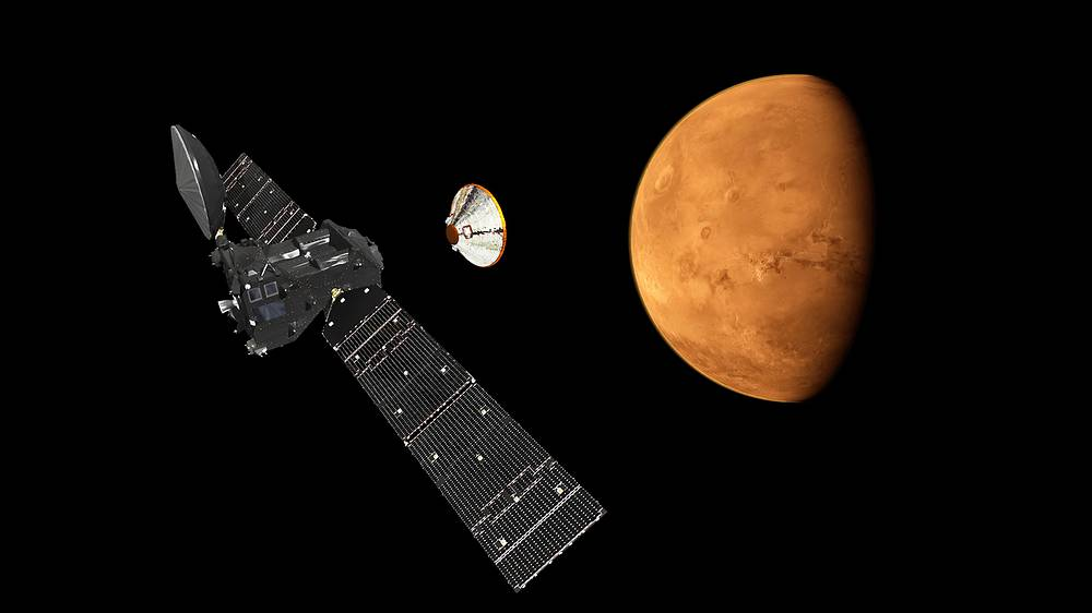 An artist's impression depicting the separation of the ExoMars 2016 entry, descent and landing demonstrator module, named Schiaparelli, from the Trace Gas Orbiter, and heading for Mars