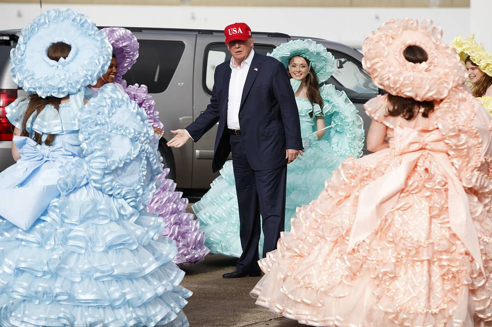 President-elect Donald Trump greeted by the Azalea Trail Maids after arriving at the airport  in Mobile, USA, December 17