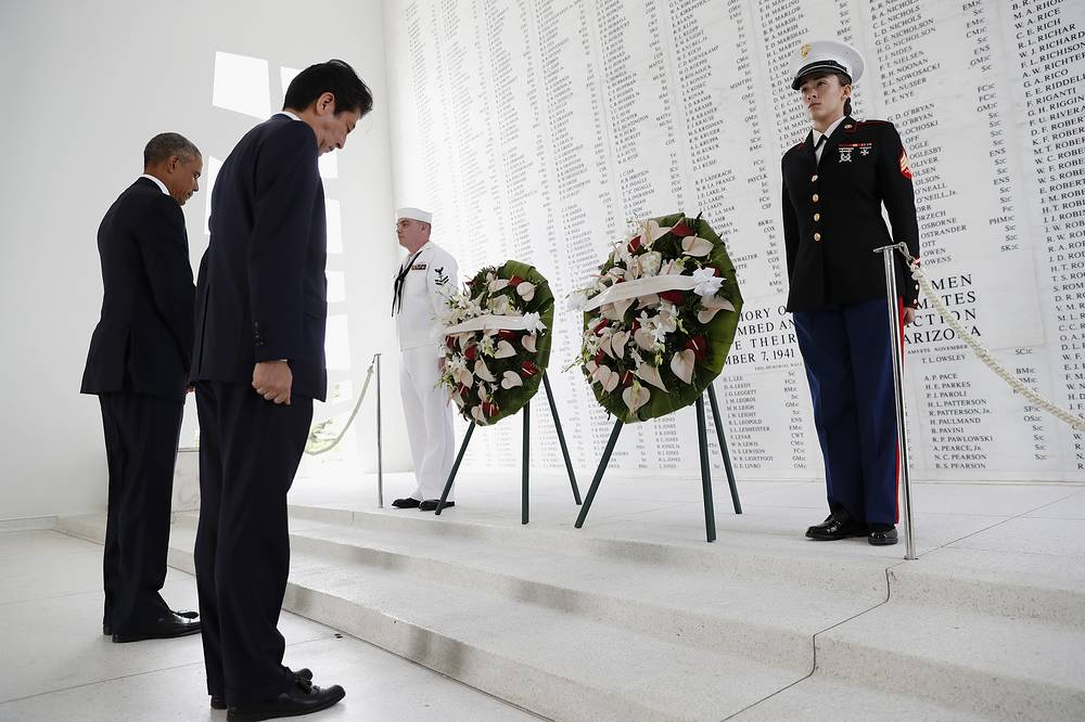 President Barack Obama and Japanese Prime Minister Shinzo Abe participate in a wreath laying ceremony at the USS Arizona Memorial, in Joint Base Pearl Harbor-Hickam, Hawaii, December 27