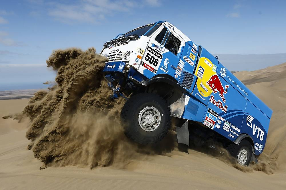 KAMAZ truck being driven up the sand dune during the Dakar Rally stage in Chile, 2014