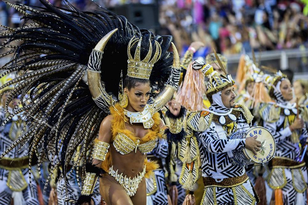 Brazilian samba dancers take part in a parade at Anhembi sambadrome as part of Carnival celebrations in Sao Paulo