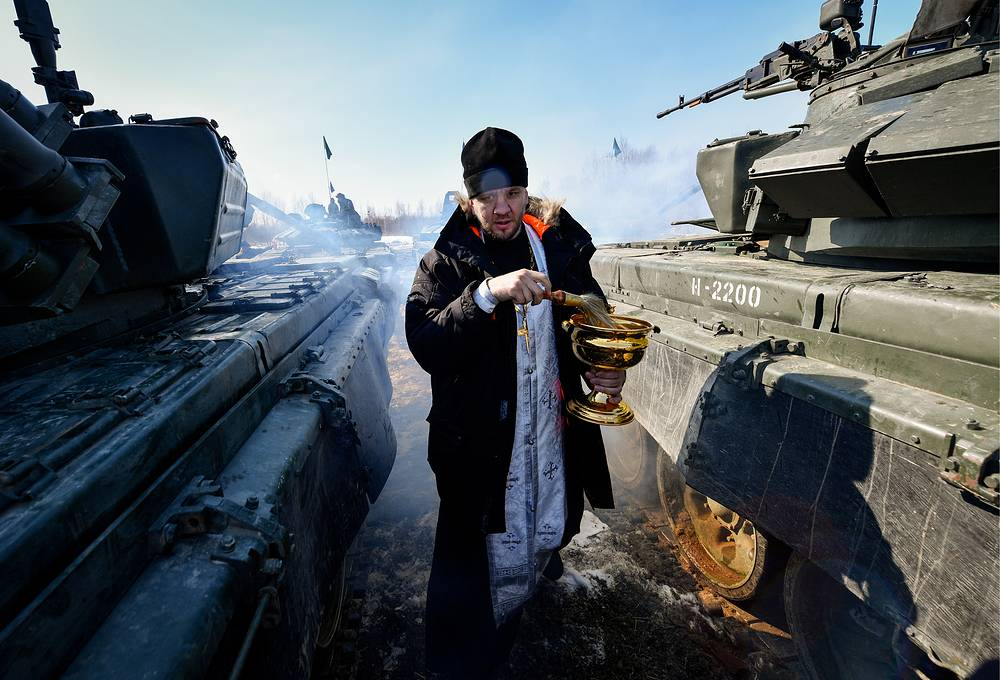 A Russian Orthodox priest before the tank biathlon competition