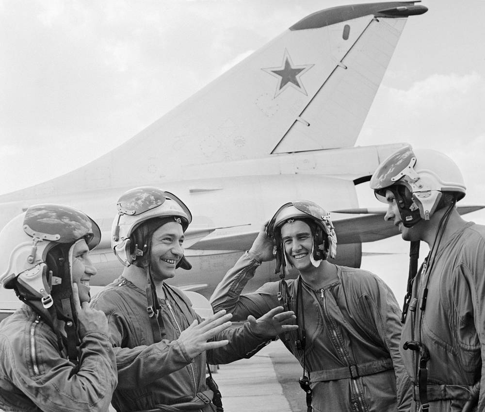 Military pilots analyzing the flight, 1972