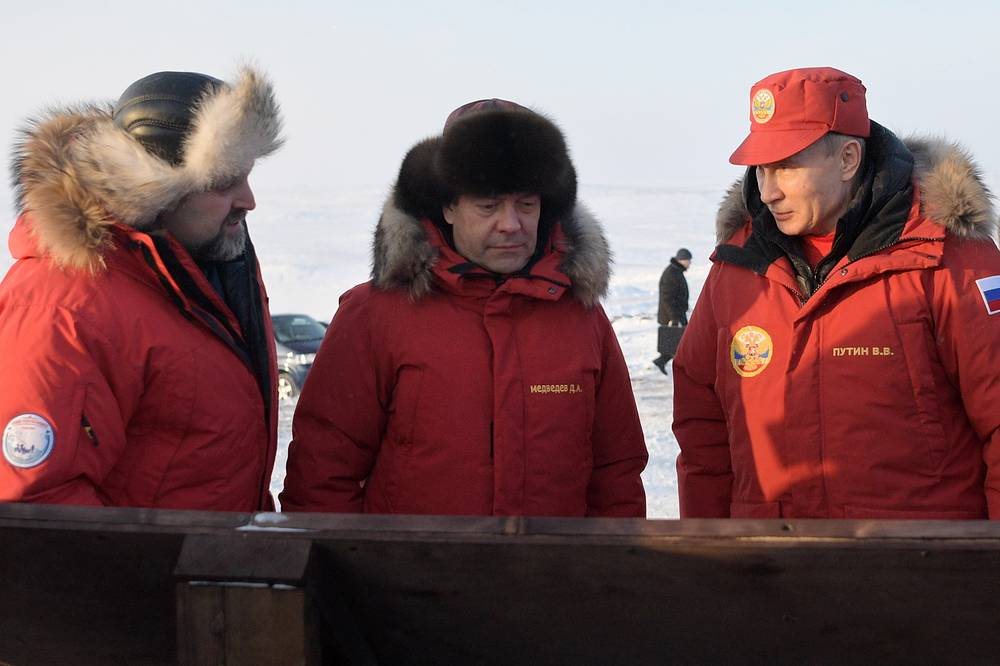 Russia's Natural Resources and Environment Minister Sergei Donskoi, Prime Minister Dmitry Medvedev and President Vladimir Putin