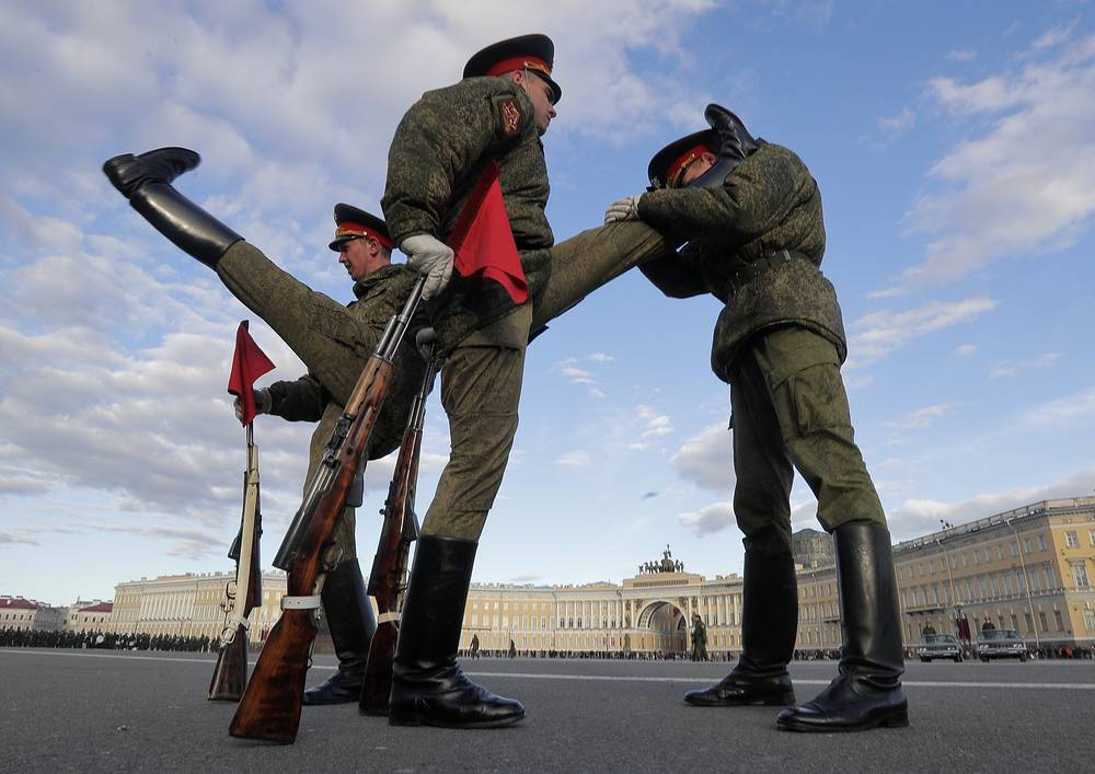 Russian honor guard soldiers warm up prior a rehearsal for the Victory Day military parade in St. Petersburg, Russia, May 3