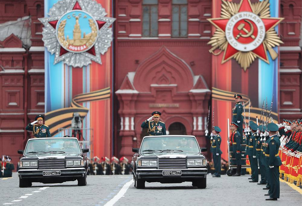 Colonel general Oleg Salyukov, Commander-in-Chief of the Russian Ground Forces, and Russia's Defense Minister Sergei Shoigu review the troops during a Victory Day military parade in Moscow's Red Square
