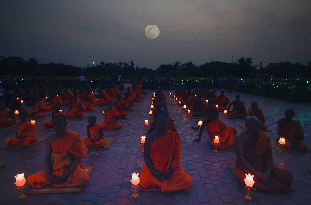 A group of Nepalese and Thai Buddhist monks attend the evening prayer at Mayadevi temple, to mark Buddha's birthday in Lumbini, Nepal, May 9