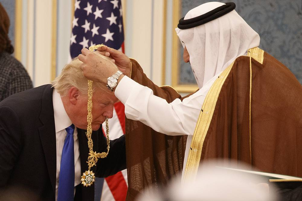 Saudi King Salman presents President Donald Trump with The Collar of Abdulaziz Al Saud Medal at the Royal Court Palace in Riyadh