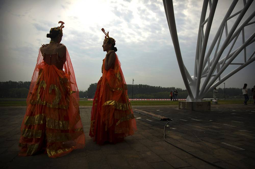 Performers in costume stand backstage before the opening ceremony of the Dragon Boat festival in Beijing