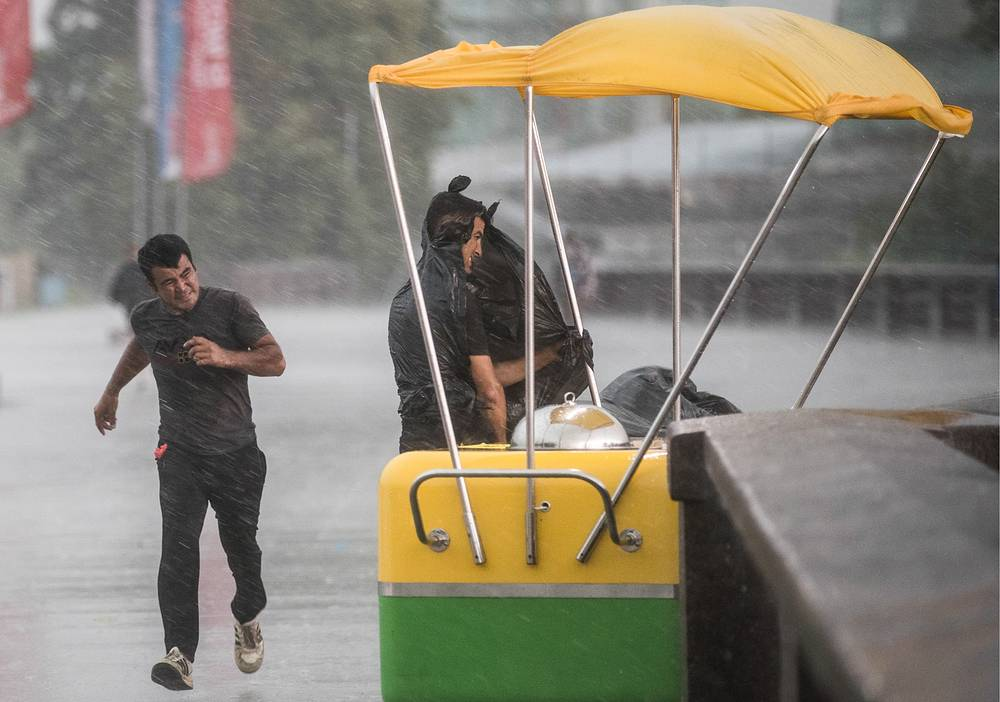 People seen during a storm in Moscow