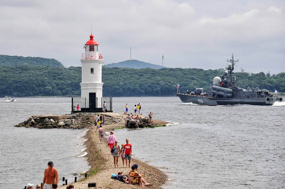 A view of the Egersheld lighthouse on the rocky Tokarevsky Spit during the Russian Navy Day parade in Vladivostok