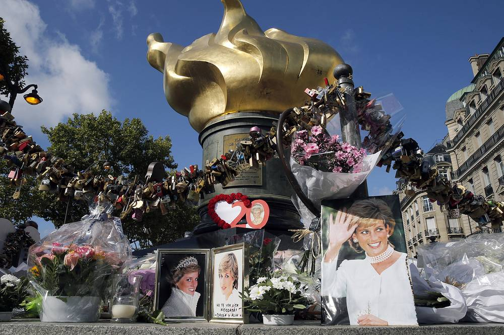 Iconic photos, flowers and messages dedicated to pay homage to Lady Diana to the 20th anniversary of her death adorn the plinth of the Flame of Liberty statue in Paris, France, August 31