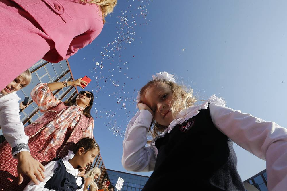 A girl attends a ceremony marking Knowledge Day at Primakov secondary school in the village of Razdory, Russia,  September 1