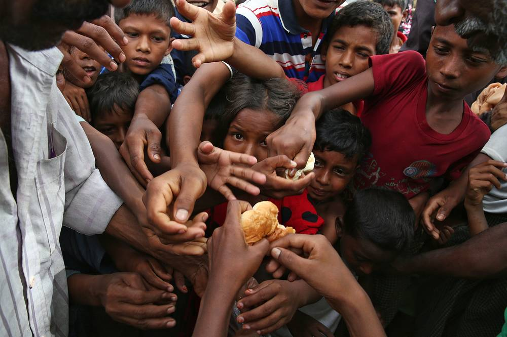 Aid officials said relief camps were reaching full capacity as thousands of Rohingya refugees continued to pour into Bangladesh fleeing violence in western Myanmar. Some 73,000 people have crossed the border since violence erupted Aug. 25 in Myanmar's Rakhine state
