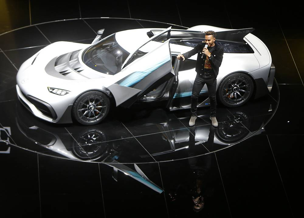 Formula One driver Lewis Hamilton leaves the Mercedes-AMG Project One hyper car after driving it onto the stage