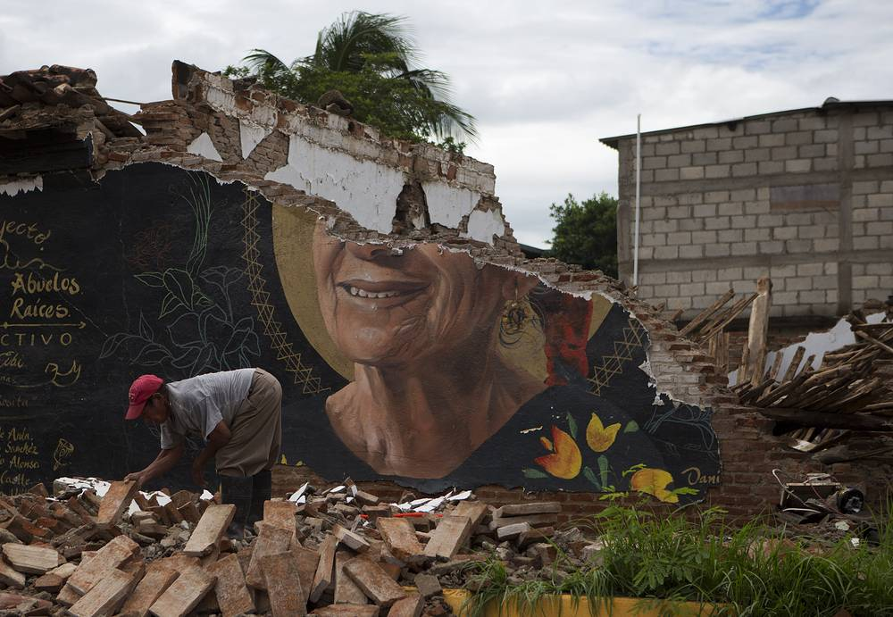 A man recovers bricks from a building destroyed in Thursday's magnitude 8.1 earthquake, in Union Hidalgo, Oaxaca state, Mexico, September 10