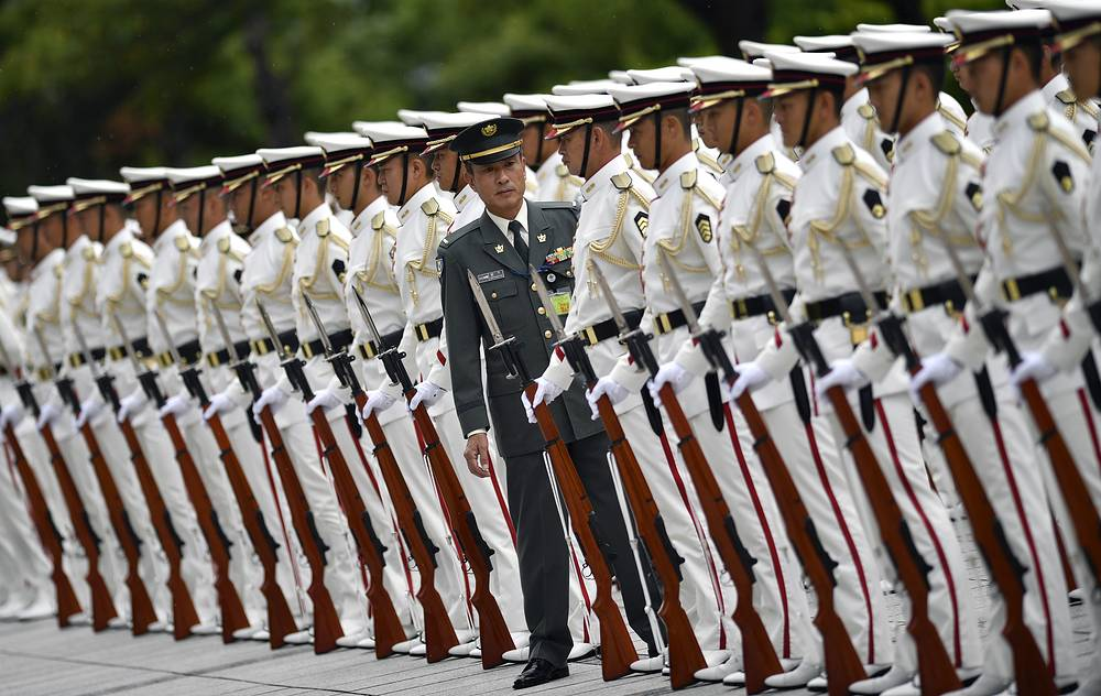 A Japan Self-Defense Force (JSDF) officer inspects the honor guard before the arrival of Japanese Prime Minister Shinzo Abe at the Defense Ministry in Tokyo, Japan, September 11