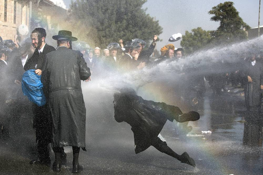 Israeli police use water cannon to disperse Ultra-Orthodox Jewish demonstrators blocking a main junction as they protest against army recruitment in Jerusalem, Israel, September 17