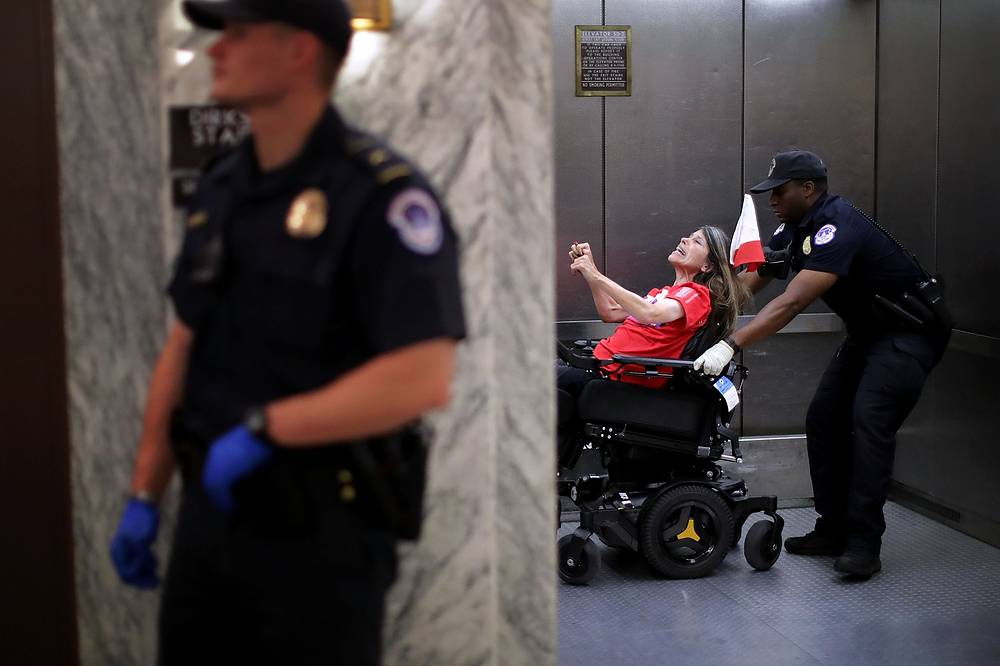 US Capitol Police arrest protesters who shouted and interrupted a Senate Finance Committee hearing about the proposed Graham-Cassidy Healthcare Bill in the Dirksen Senate Office Building on Capitol Hill in Washington, USA, September 25