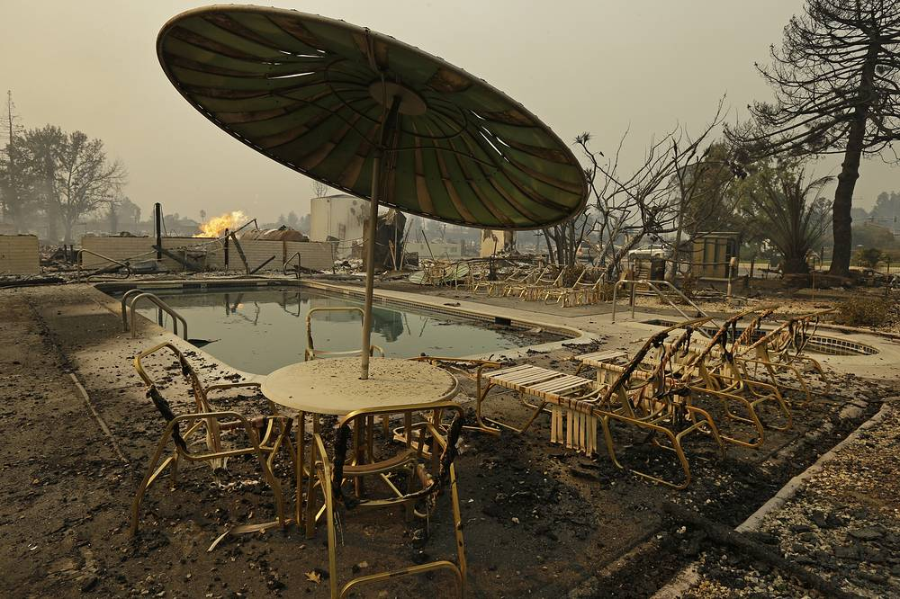Fire burns from an open gas valve near the pool area at the Journey's End trailer park after a wildfire destroyed nearly all of the roughly 160 units in the park for residents over age 55, Santa Rosa, USA, October 9