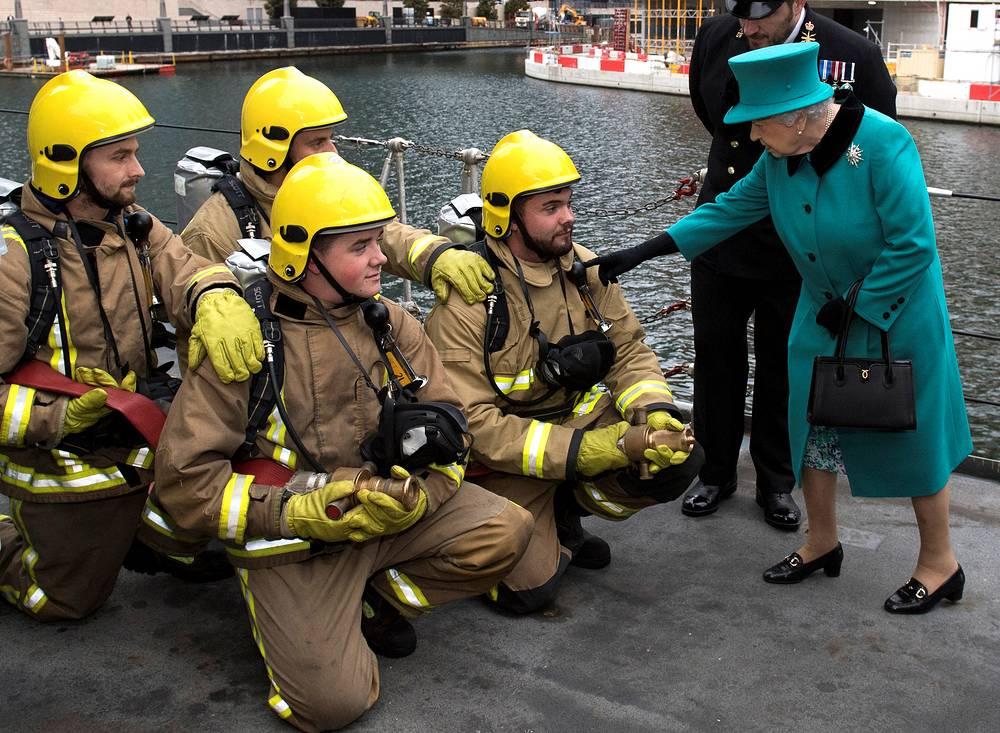 Britain's Queen Elizabeth II visits HMS Sutherland in the West India Dock, London, Britain, October 23
