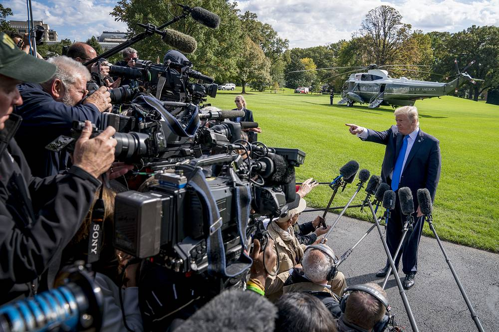 US President Donald Trump calls on a reporter before boarding Marine One on the South Lawn of the White House in Washington, USA, October 25