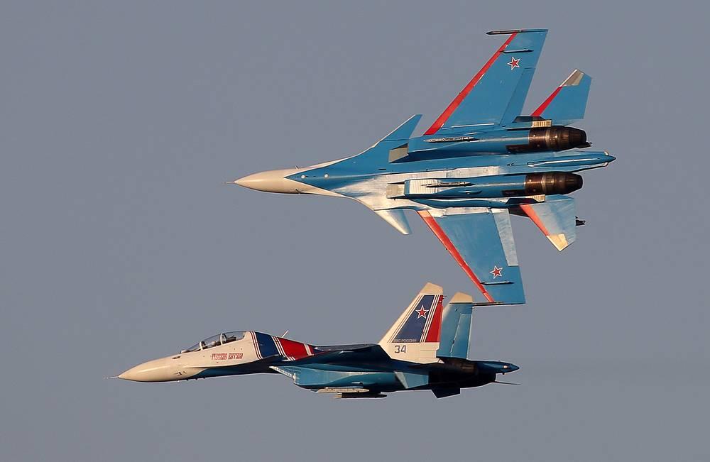 Sukhoi Su-30SM jet fighters of the Russkiye Vityazi aerobatic team perform at the 2017 Dubai Airshow