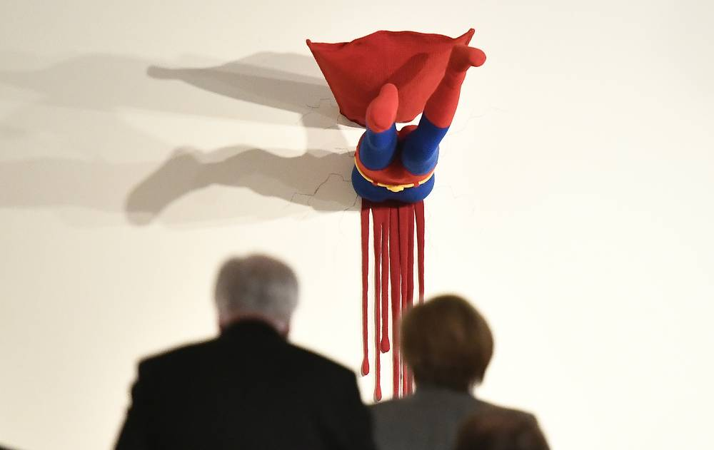 Minister President of Bavaria and Chairman of the German Christian Social Union party, Horst Seehofer and German Chancellor Angela Merkel examine artwork at the federal state residence of Baden Wuerttemberg in Berlin, Germany, November 19