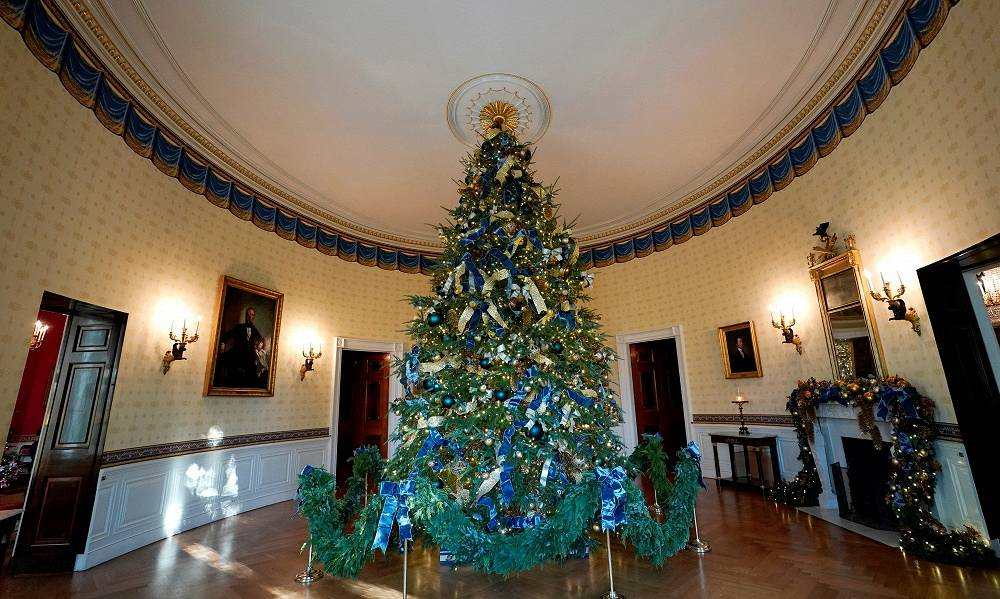 The official White House Christmas tree adorns the Blue Room of the White House