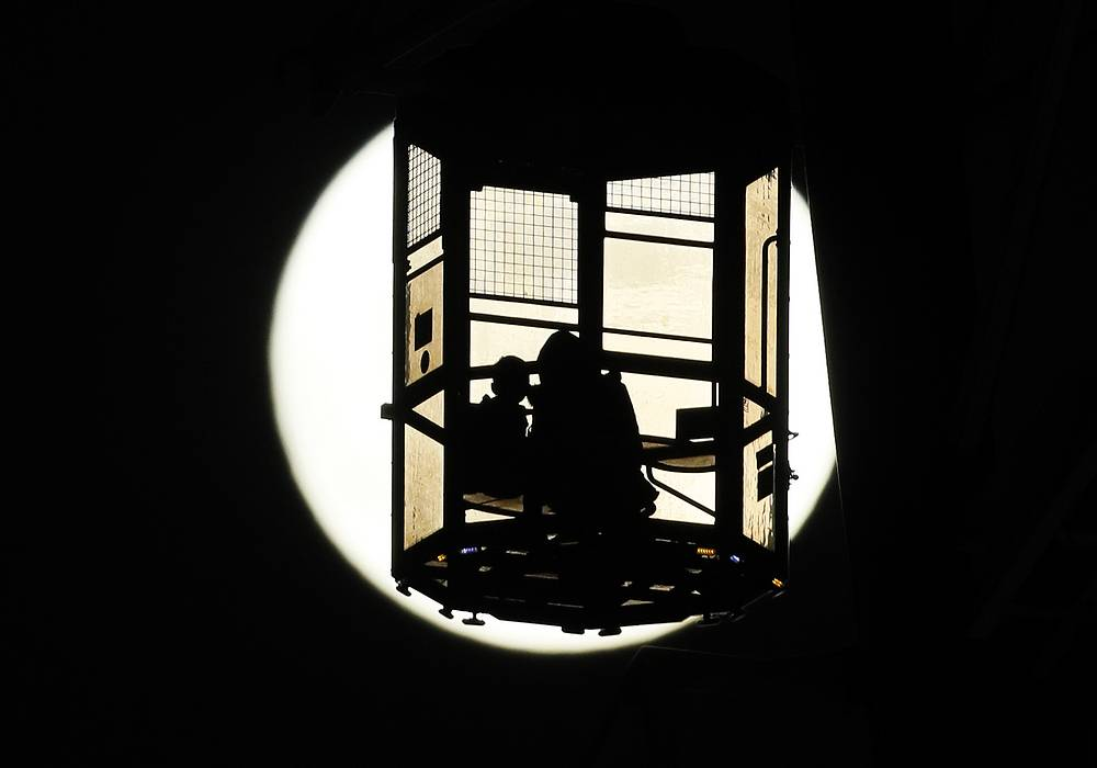 Visitors enjoy viewing the so-called 'Supermoon' from a gondola of a ferris wheel at an amusement park in Tokyo, Japan