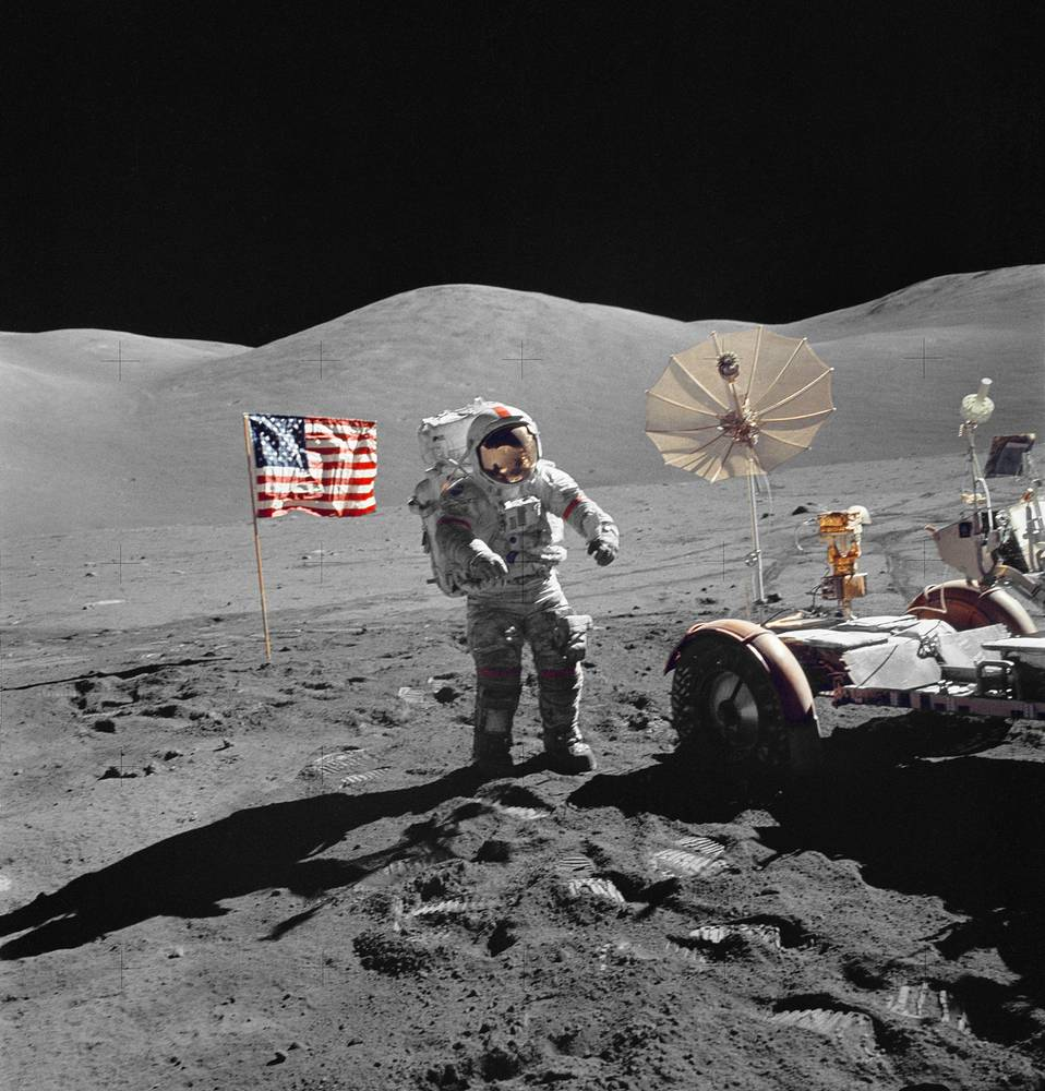 Astronaut Eugene A. Cernan, mission commander, walks toward the Lunar Roving Vehicle during extravehicular activity at the Taurus-Littrow landing site on the moon