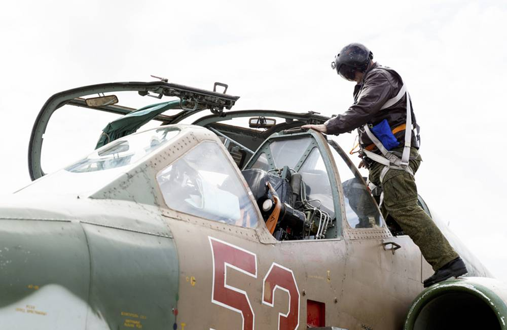 A Russian pilot gets into a cockpit of a Su-25 ground attack jet before a take off at Hmeymim airbase in Syria, March 15, 2016