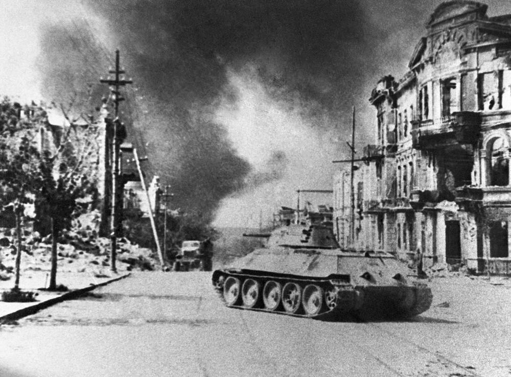 A Soviet T-34 tank on a street after Sevastopol was liberated by the Red Army, 1944