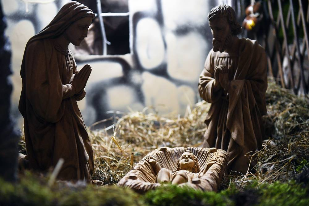 A nativity scene on display at the Cathedral of the Transfiguration during a traditional Christmas Eve Mass in Novosibirsk, Russia