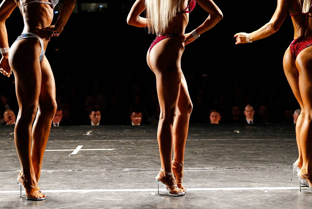 Women compete in a ladies' event at the 2017 Kaliningrad Region Bodybuilding and Fitness Championship, Kaliningrad, October 15