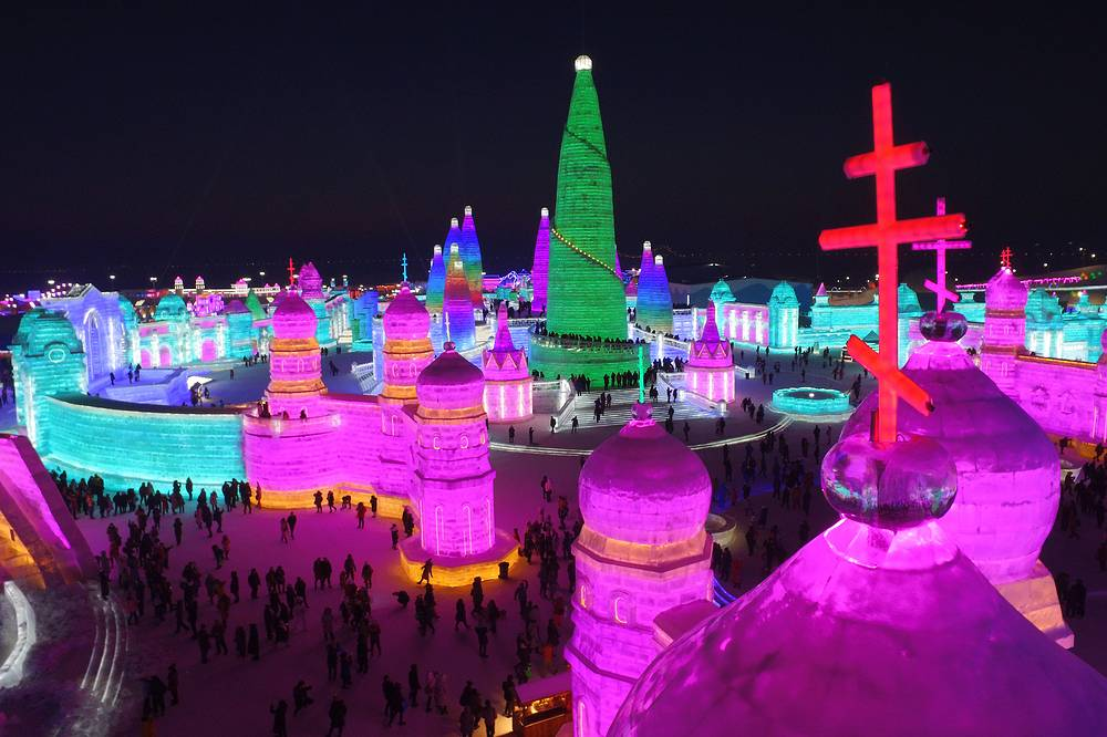 People visit the colorful illuminated ice sculptures at the Harbin Ice and Snow World